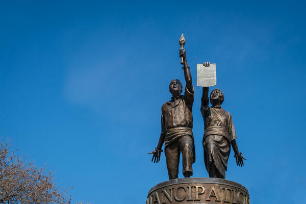 Isolated view of Emancipation statue near the state capitol building set against brilliant blue sky.